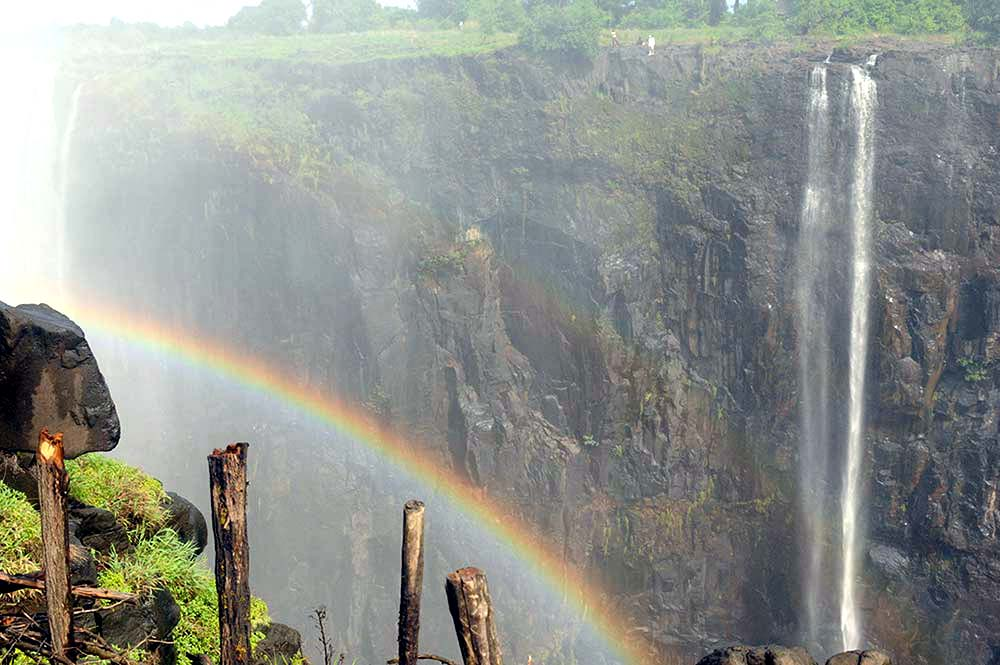 Image of a rainbow at Victoria Falls in Zimbabwe. Photo credit: K.J. Howe, award-winning author of the Thea Paris series.